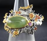 Серебряное кольцо с пренитом и сапфирами